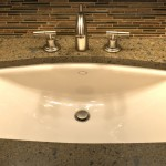 Oblique Lavatory and Faucet in vanity with granite top