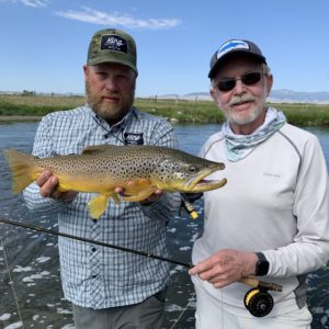 Dave King of King Outfitters prepares to release the author's 22-inch brown trout.