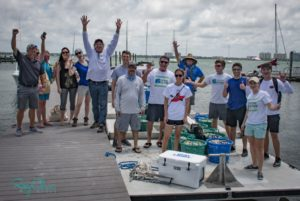Sarasota Bay Watch members and volunteers celebrate one of their 2018 clam releases. - Rusty Chinnis | Sun